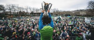 Román Torres holding aloft the MLS Cup for the Seattle fans to see.